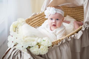 Little baby girl in a beautiful dress