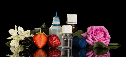 Set of fragrant liquids for smoking electronic cigarettes, berries and flowers isolated on black