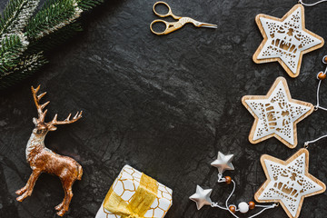 Christmas decoration on black background, flat lay, top view.