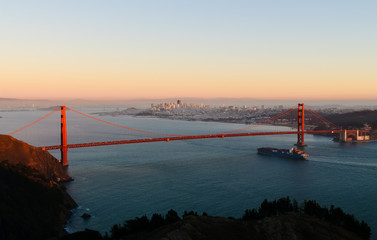 Canvas Prints Bridge Container ship passing under the Golden Gate bridge at sunset portraying the importation of everything from China