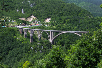 Durdevica Tara Bridge was designed by Mijat Trojanovic, was built between 1937 and 1940 in the Kingdom of Yugoslavia. The project's Chief Engineer - Isaac Russo