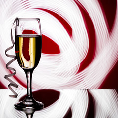 glass of champagne on  red background.
