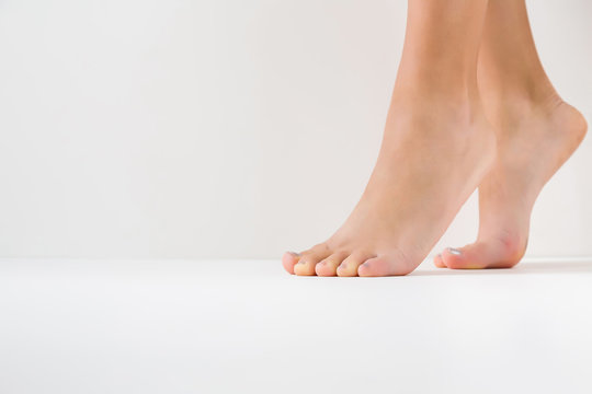 Barefoot. Cares about a woman's clean and soft foot skin. Body care concept.