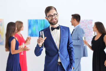 Young man in formal wear at art gallery exhibition