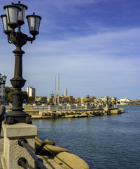 panoramic views of the waterfront of Bari, Puglia - Italy.In the foreground the characteristic lamppost