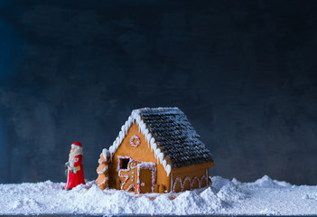 Gingerbread House. Santa Claus passing gingerbread house