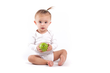cute beauty little girl in white pijamas with apple