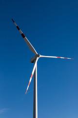 white wind power plants in a field