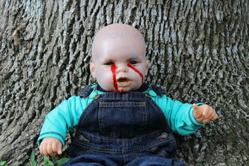 Bloody Boy Doll in Overalls by Tree