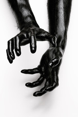 Abstract shot of human hands painted in black