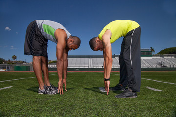 Two track athletes warming up
