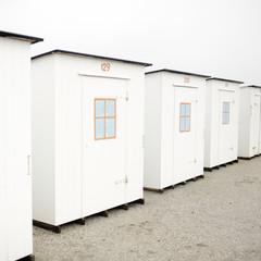 A row of beach cabins