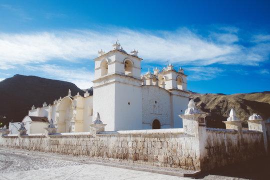 Beautiful colonial white stone church in Yanque, Peru