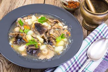 Black plate with wild mushroom soup
