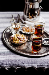 Turkish tea, nibbles and sugar on a tray
