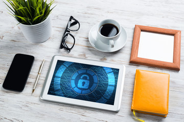 Web security and technology concept with tablet pc on wooden table