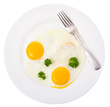 Fried eggs on white plate for breakfast