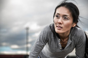 Athletic woman hunched over