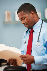 Pediatrician: Doctor Checking Patient Information