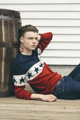 Cool teenager wearing all American colors, red white and blue