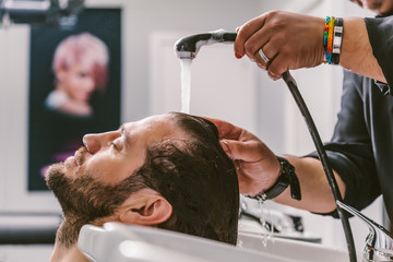 Barber Washing Hair to a Client