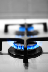 Close up of two gas stove flame, domestic gas consumption concept