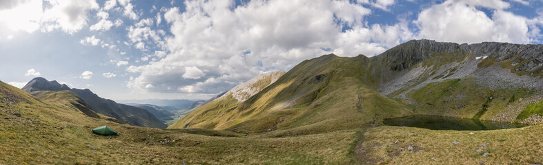 Panorama shot of scottish highlands with a small lake