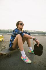 Urban woman with longboard