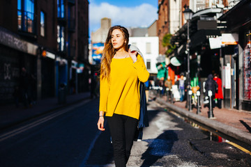 Young Blonde Woman Walking in the Middle of the Street. Dublin City