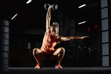 Female crossfit athlete exercising