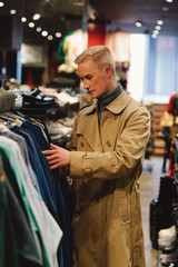 fashionable man shopping for vintage clothes.