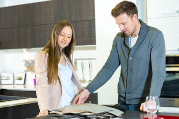 woman customer choosing tiles for her future kitchen