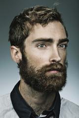 A portrait of a bearded man