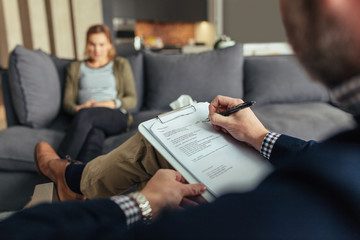 Psychologist during therapy session with female patient
