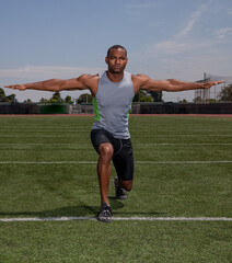 Man stretching for a track and field event