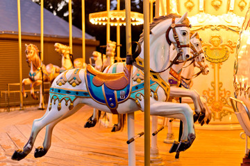 Illuminated retro carousel at night