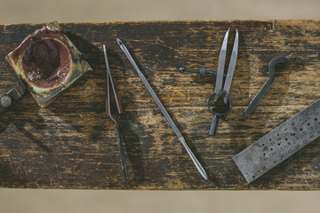 Still life shot of tools used for artisan jewelry making