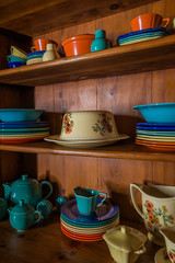 Antique Dishes in a Wooden Hutch