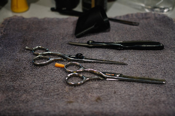 Scissors on counter at barber shop
