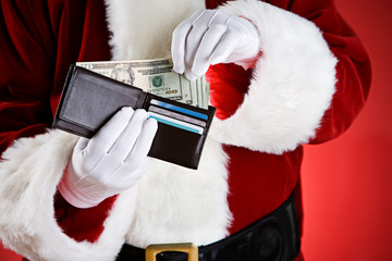 Santa: Pulling Cash Out Of Wallet
