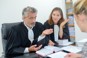 robed lawyer in meeting with client