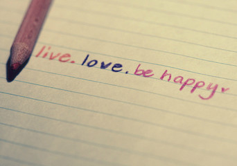 Handwritten message saying Live, Love, Be Happy