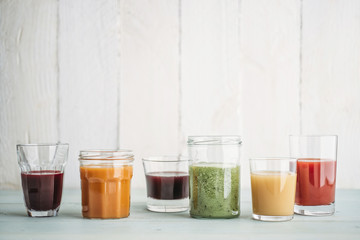 Food: Different colorful smoothies in glasses