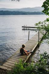 Child Playing at Lake Early Morning