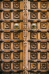 Old wooden door decorated with flower pattern