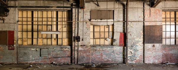 An old, run down warehouse  wall
