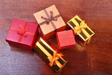 Christmas decoration with gift boxes on a wooden desktop