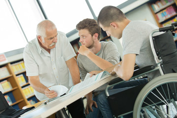 student in wheelchair in class