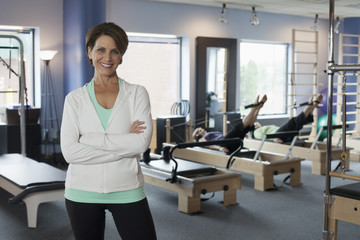 Business owner in her Pilates fitness studio open for business