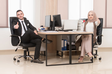 Happy Businessman and Muslim Woman Thumbs Up Sign